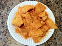 Nacho cheese chips and melted cheddar cheese
